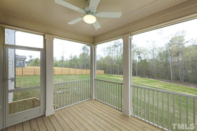 spacious rear screened deck overlooking backyard and woods