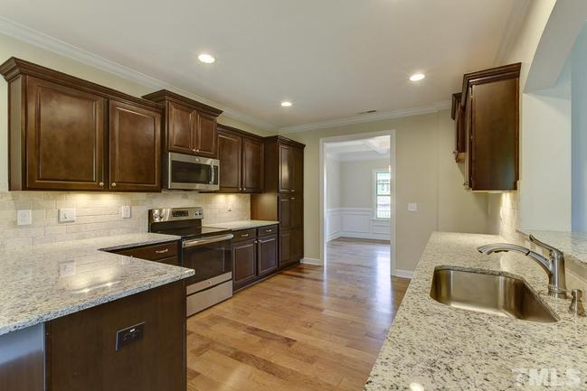 beautiful gourmet kitchen with granite counters