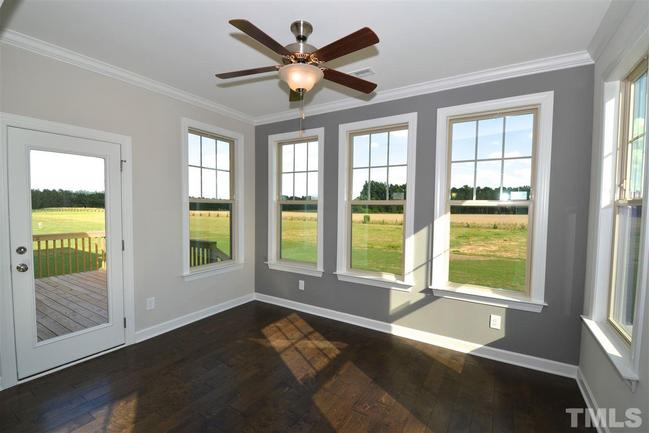 bright and sunny sunroom with fan