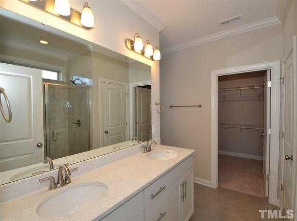 spacious master bathroom with dual sinks