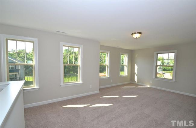 carpeted family room with lots of windows