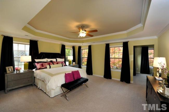 expansive master suite with sitting room