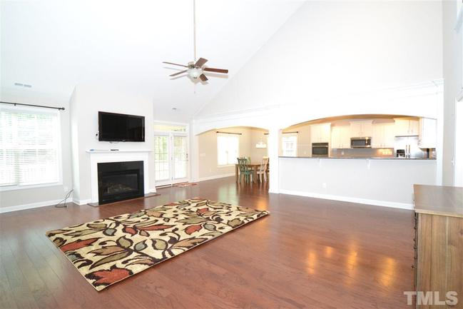 spacious family room with vaulted ceiling