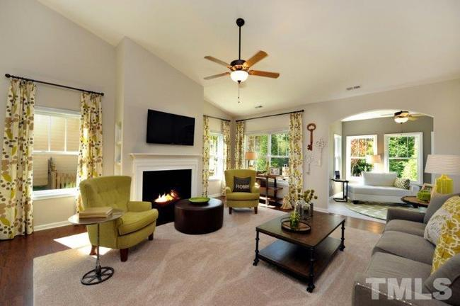 spacious family room with fireplace and vaulted ceilings