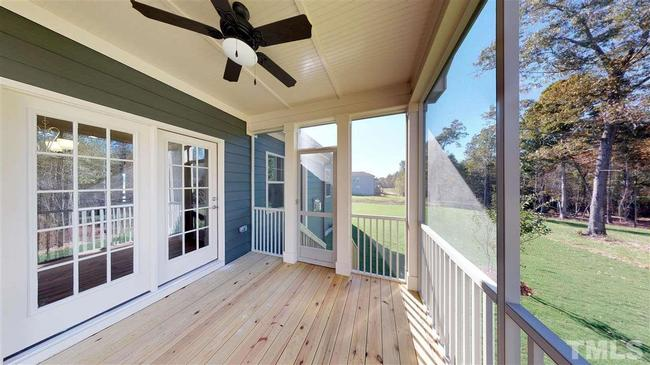 screened back deck with wooded views at 246 w wellesley drive